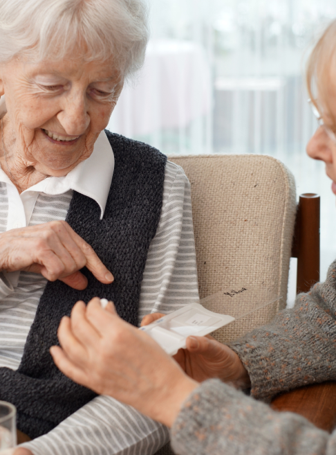 90-year-old-lady-at-home-with-her-carer-choosing-medication-this-file-has-a-professional-witnessed_t20_6y1jP6 1